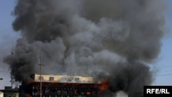 A shopping center burns in central Kabul on January 18.