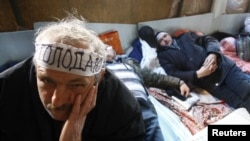 Scores of Chornobyl veterans stages a sit-in protests in Donetsk late last year.