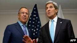 U.S. Secretary of State John Kerry (right) and Russian Foreign Minister Sergei Lavrov talk to reporters in Brunei on July 2.