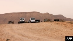Tunisian military vehicles and Emirati Red Cross jeeps are parked near a border post with Libya (file photo).