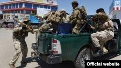 Сотрудники афганских сил безопасности в провинции Кундуз. 28 сентября 2015 года.