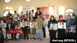 Afghan journalists hold the pictures colleagues killed in recent years (file photo, November 2014)