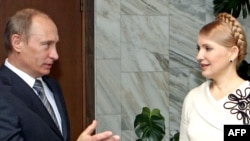 Prime Minister Vladimir Putin (left) with his Ukrainian counterpart Yulia Tymoshenko will meet in October.