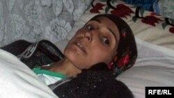 Ауырып жатқан тәжік әйелі. Душанбе, 27 қазан 2009 жыл.