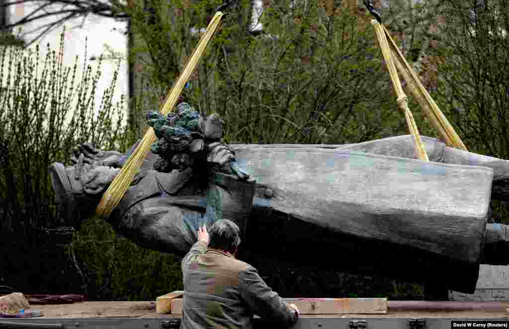 A statue of Soviet World War II commander Ivan Konev is loaded onto a truck after being removed from its platform in a Prague district on April 3. Konev is regarded as a hero in Russia for retaking much of Eastern Europe from Nazi German forces during World War II. But many Czechs view him an enforcer of Soviet rule after the war. A local assembly voted in 2019 to remove the statue. (Reuters/David W. Cerny)