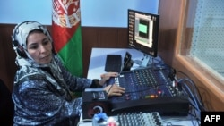 An Afghan female journalist works in the studio of Shahrzad, a women's radio station, in Herat.