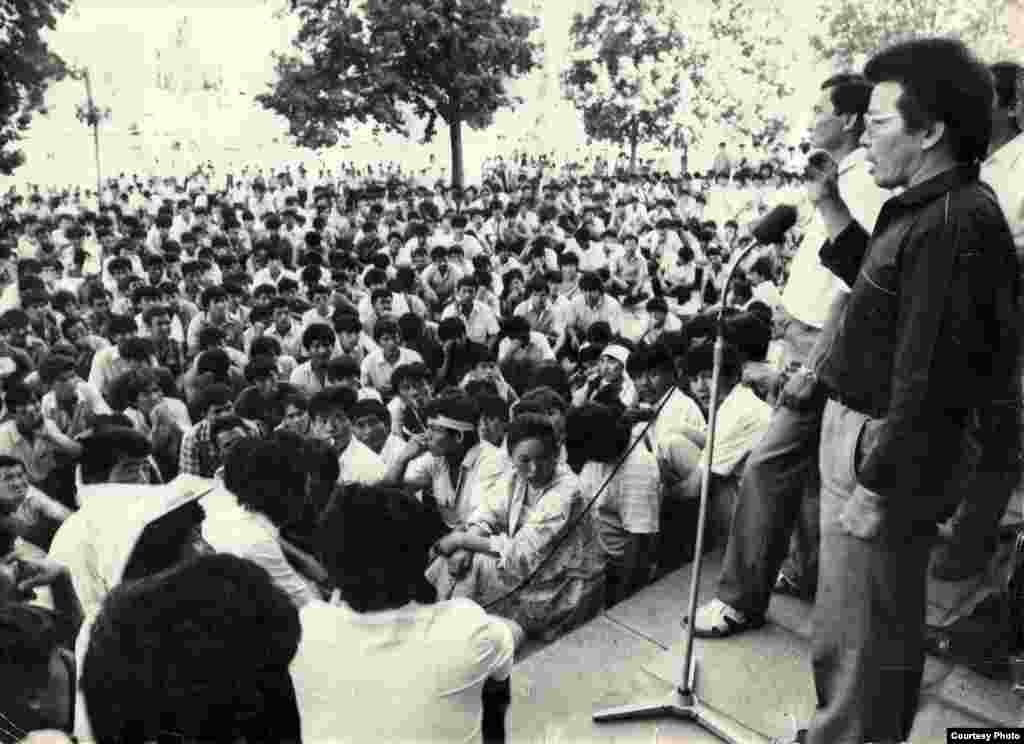 Topchubek Turgunaliev (first right on stage) and Jypar Jekshe (second right on stage), co-chairmen of the Kyrgyzstan Democratic Movement anticommunist bloc, address a rally in Frunze's (now Bishkek) Ala-Too Square demanding peace in the southern Osh region and democratic reforms in the Soviet Kyrgyz republic on June 5, 1990.