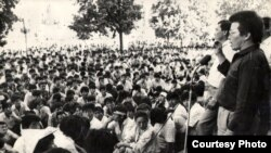 Topchubek Turgunaliev (right) and Jypar Jeksheev, two of the five co-chairmen of the Kyrgyzstan Democratic Movement, address a protest rally demanding democratic reforms in central Bishkek on June 5, 1990.