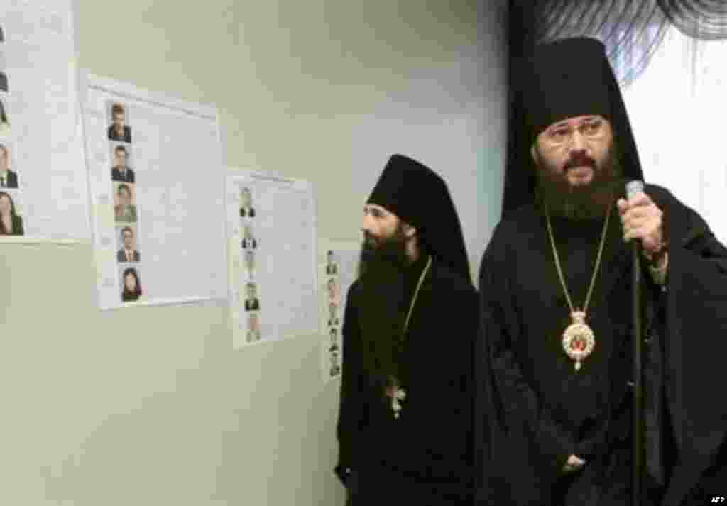 Orthodox priests consult candidate lists in the capital
