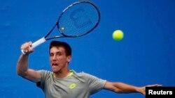 Damir Džumhur tokom meča sa Ivanom Dodigom na Australian Openu