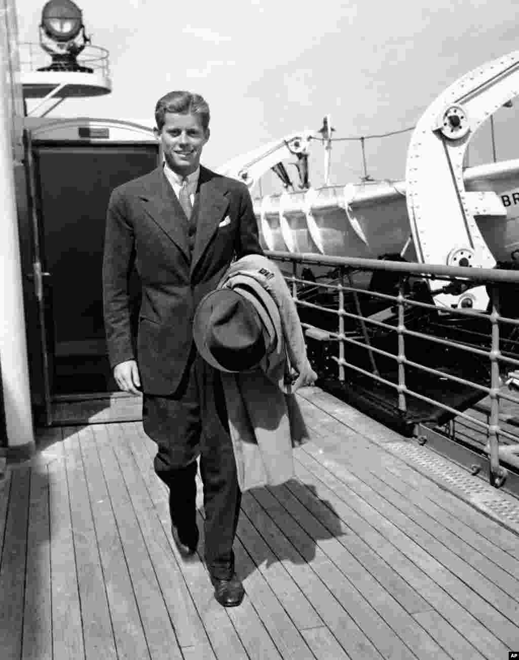 John F. Kennedy returns to New York after a summer holiday in Europe in 1938, three years before beginning the wartime naval service that would propel him into Congress and ultimately the U.S. presidency.
