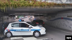 A municipal police vehicle blocks an underpass leadiing to the scene of an attack in Saint Etienne du Rouvray, near Rouen, France on July 26.
