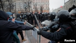 Law enforcement officers clash with participants during a rally in support of jailed Russian opposition leader Aleksei Navalny in Moscow on January 23.