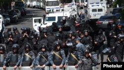 Riot police are deployed on Marshal Bagramian Avenue leading to the parliament building in Yerevan on April 17.