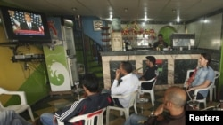 Libyans at a shop in Benghazi watch a television broadcast of U.S. President Barack Obama's May 19 speech on the Middle East.