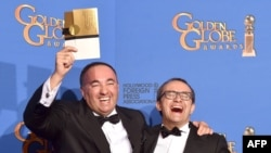 Writer/producer Aleksandr Rodnyansky (left) and director Andrei Zvyagintsev, winners of Best Foreign Language Film for Leviathan, pose in the press room during the 72nd Annual Golden Globe Awards at The Beverly Hilton Hotel on January 11.