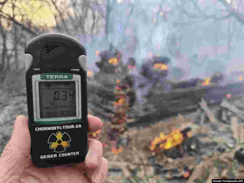 A Geiger counter showed an increase in radiation levels near the village of Volodymyrivka in the exclusion zone around Chernobyl on April 5.