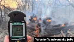 Emergency workers test radiation levels in the Chernobyl exclusion zone on April 5.