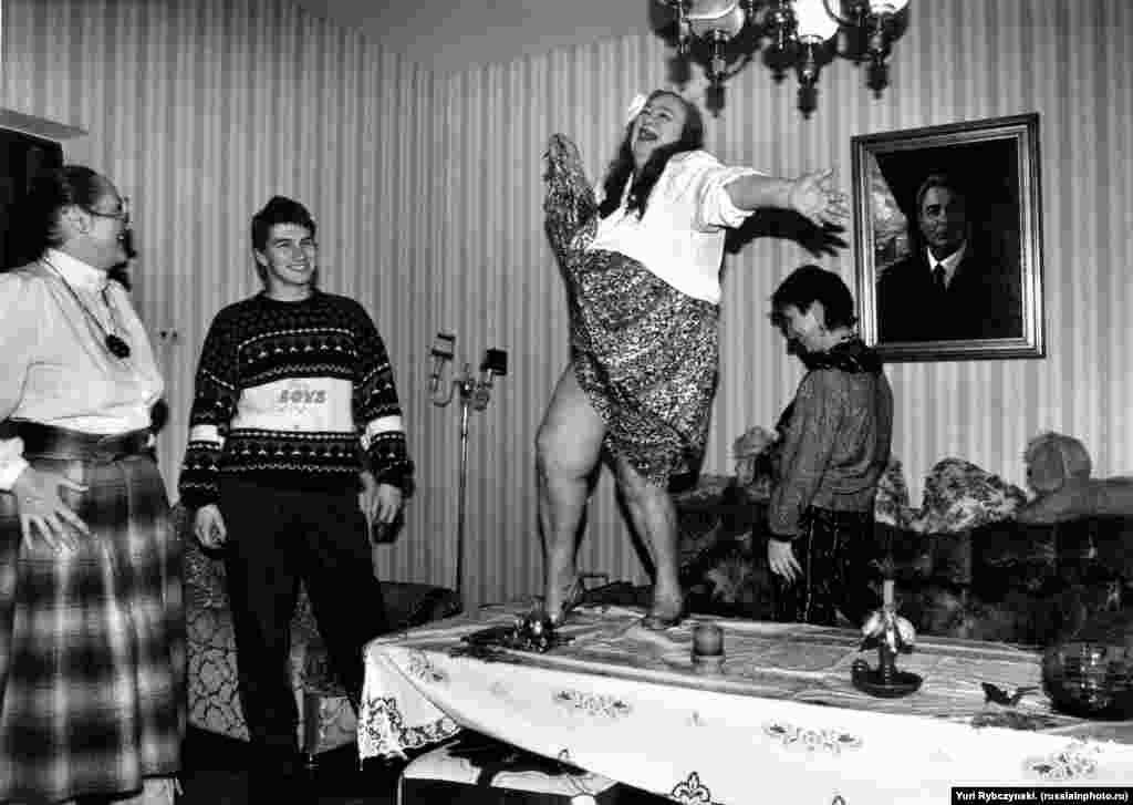"Galina Brezhneva, the daughter of Soviet leader Leonid Brezhnev, dancing on a table during a ""home holiday"" in the early 1990s."