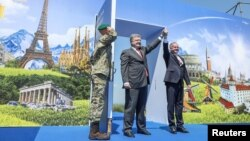 "Ukrainian President Petro Poroshenko (left) met with Slovak his counterpart, Andrej Kiska, on the Slovak-Ukrainian border on June 11, opening a symbolic ""door to the EU."""