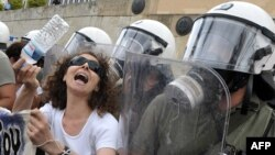 A woman protests in front of the Greek parliament during a demonstration march against austerity measures earlier this year.