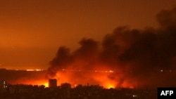 Smoke billows from fires raging on the edge of Gaza City on January 5.