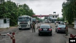 Russian soldiers man a border station near Benderi, in Moldova's breakaway Transdniaster, in this 2013 photograph.