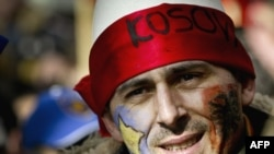 A Kosovar man celebrates on the first anniversary of Kosovo's independence declaration on February 17 of this year.