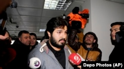 TURKEY -- Turkish-Iranian businessman Reza Zarrab, who is charged currently in the U.S. for evading sanctions on Iran, is surrounded by the media members as he arrives at a courthouse in Istanbul, December 17, 2013