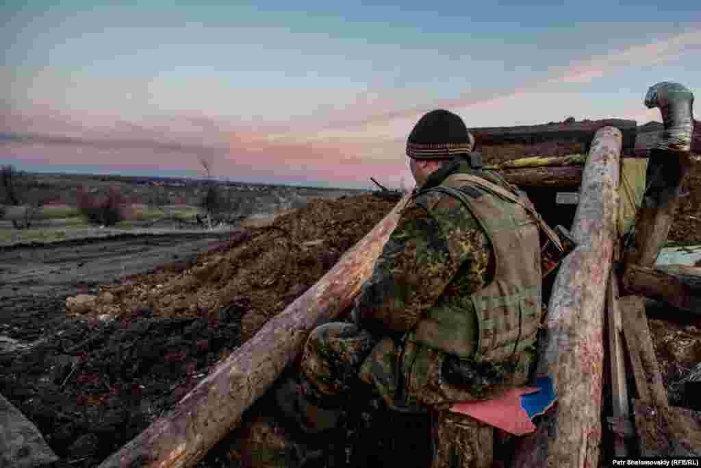 A serviceman keeps an eye on enemy positions near Zaytseve.