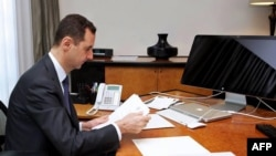 Syria -- President Bashar al-Assad in his office in the capital Damascus, 13Jun2013