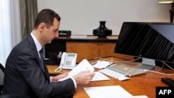 Башар Асад у сваім офісе ў Дамаску (чэрвень 2013 году)