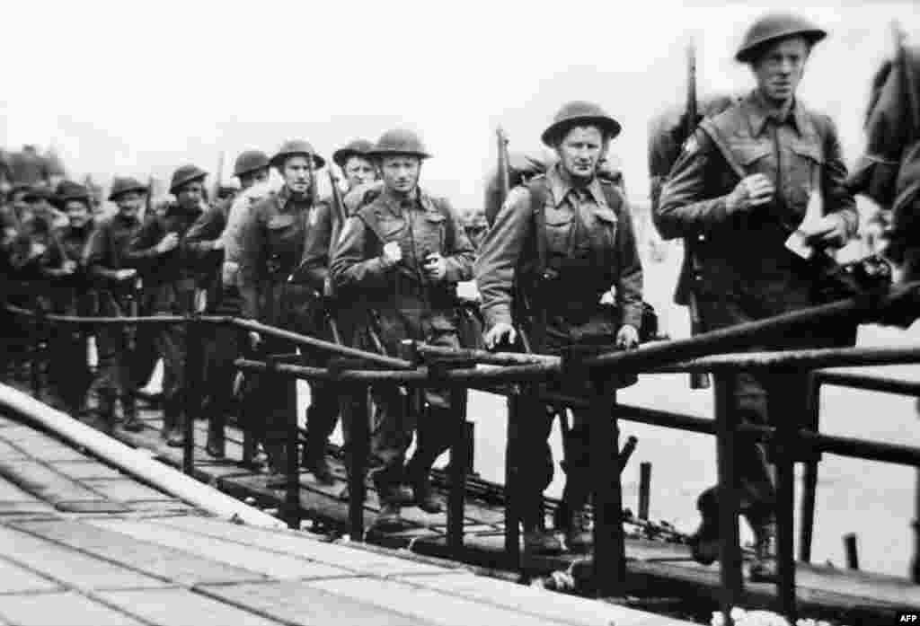 Picture released on June 5, 1944 of the British troops embarking at Southsea, Portsmouth in England, before a landing craft on June 6, 1944 while Allied forces storm the Normandy beaches on D-Day