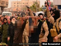 """The Islamic State said it also crucified two men for """"banditry."""""""