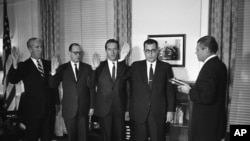 Secretary of Defense Robert McNamara swearing in four top Defense officials on Oct. 1, 1965 Dr. Harold Brown, Secretary of the Air Force