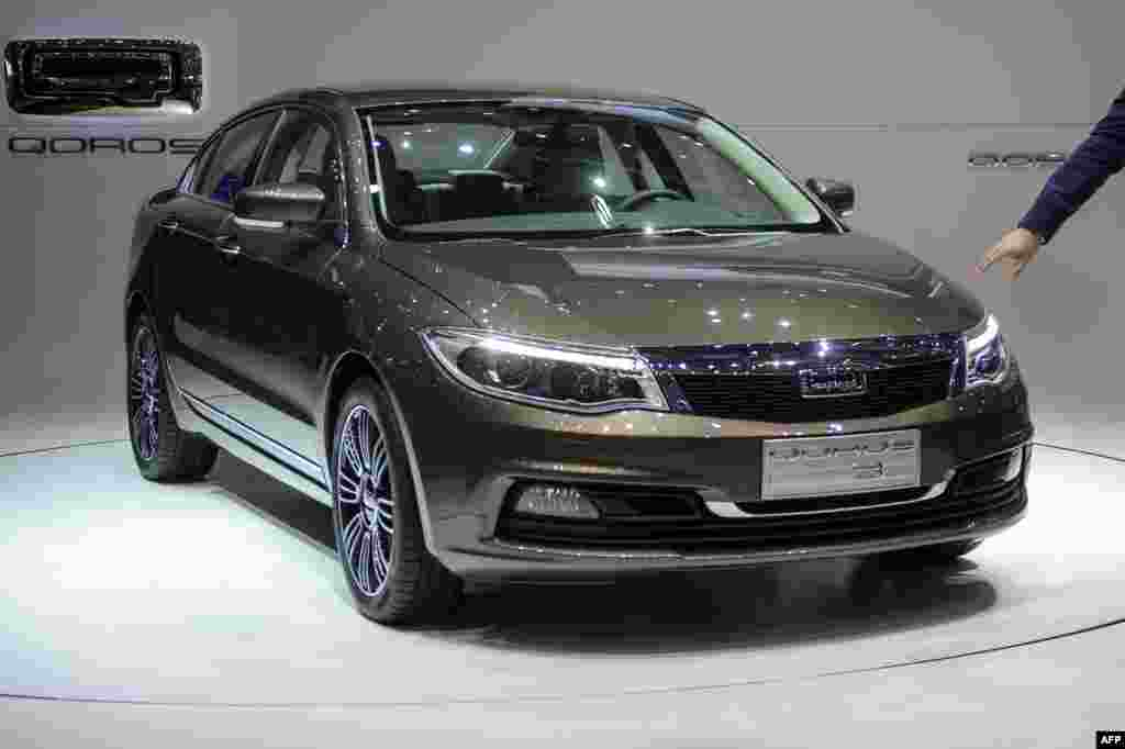 A Qoros 3 sedan is displayed as a European premiere for this Chinese car maker.