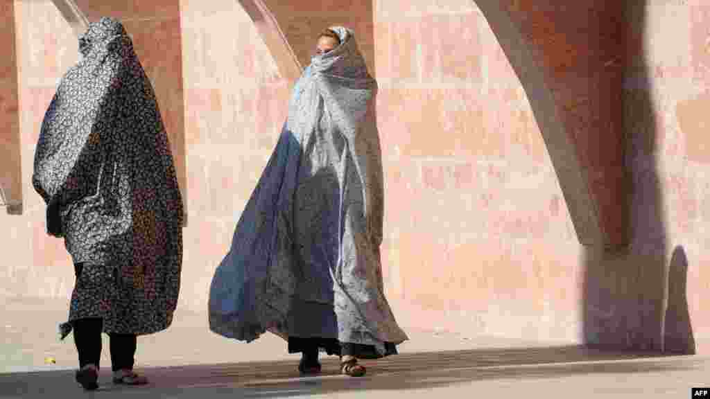 Azerbaijani women walk to prayers at the Pink Mosque in Nardaran near Baku on July 30. (AFP/Vano Shlamov)
