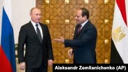 Egyptian President Abdel-Fattah El-Sissi (right) with Russian President Vladimir Putin in Cairo last year.