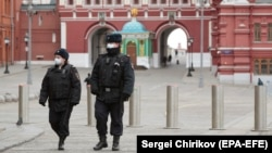 Russian police officers patrol a deserted Red Square in Moscow, which went into lockdown on March 30.