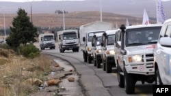 Syrian Red Crescent aid convoys carrying food, medicine, and blankets leave the capital, Damascus, as they head to the besieged town of Madaya on January 11.