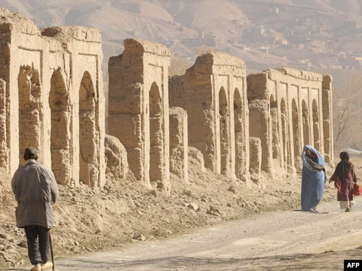 Afghans walk in the old city of Bamiyan, on an old Silk Road trade route.