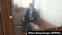 Nurbek Qushaqbaev in an Astana courtroom on April 3