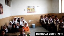 Afghan schoolchildren attend a class at the Shahid Nasseri refugee camp in Taraz Nahid village near the city of Saveh, some 130 kms southwest of the capital Tehran, on February 8, 2015.