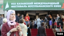 People gather outside a cinema during the International Festival of Muslim Cinema in Kazan.