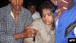 A Bangladeshi woman is rescued from the capsized ferry in the remote coastal village of Bhola.