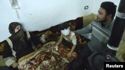 Хомс қаласына шабуыл кезінде жараланған адамдар. Хомс, Сирия, 6 ақпан 2012 жыл.