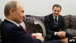Russia's then-prime minister, Vladimir Putin (left), speaks with U.S. actor Leonardo DiCaprio in St. Petersburg in November 2010, after a concert to mark the International Tiger Conservation Forum.