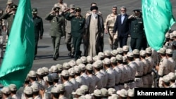 Supreme Leader Ayatollah Ali Khamenei walks alongside military officials, during a gradation ceremony at Tehran's police academy on September 17.