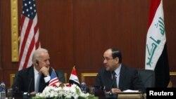 المالكي وبايدن ـ بغداد 2011 (من الارشيف)