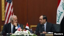 Заменик претседателот на САД Џо Бајден и ирачкиот премиер Нури ал-Малиќи на прес-конференција во Багдад.